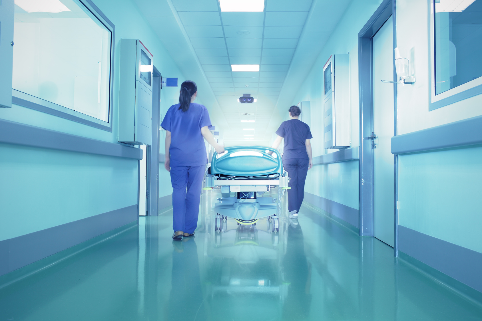 Bright lights at the end the hospital corridor. The concept of l